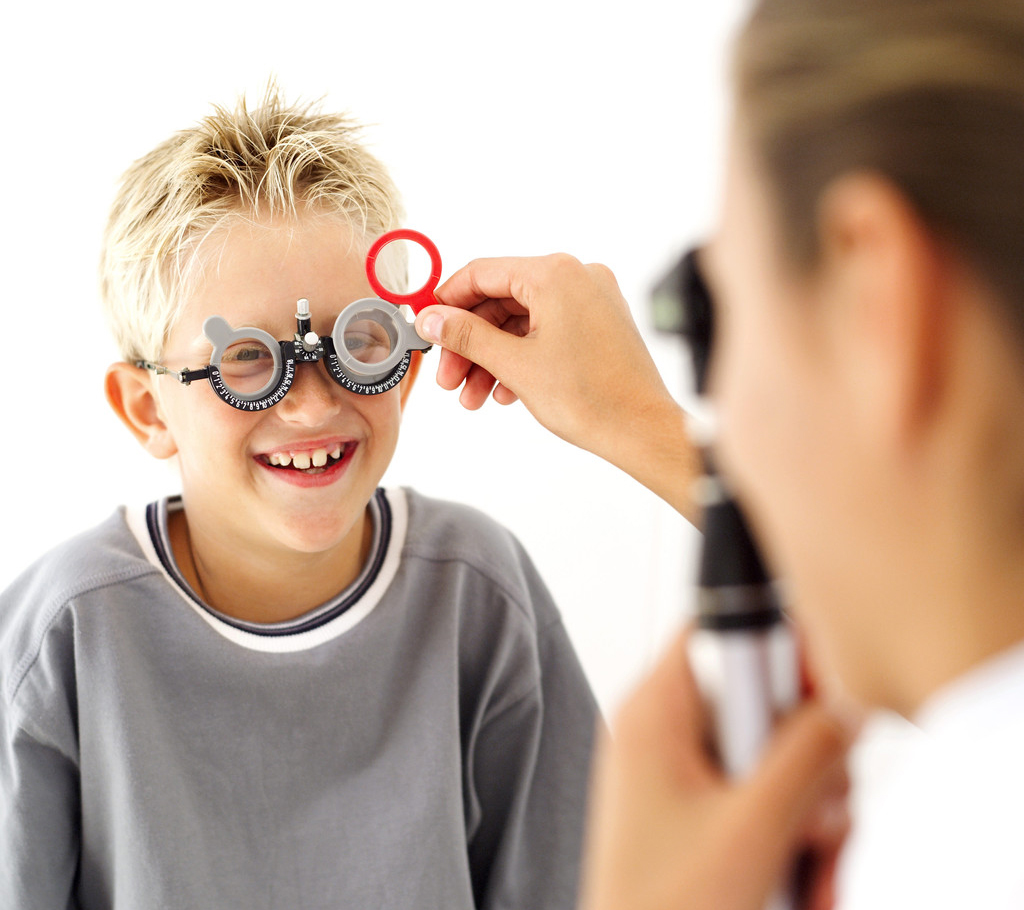 Eye care services instore optician independent family eyecare young medical professional checking the eyes of young boy 8 10 geenschuldenfo Images